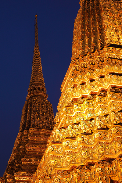 Two chedi at night.